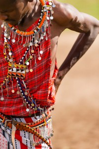 Masai Warriors traditionally wear vibrant red clothing called a shuka
