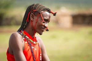 A Masai Warrior dressed in traditional garb