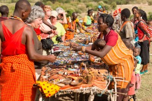 Travelers meeting the Masai and shopping for local crafts