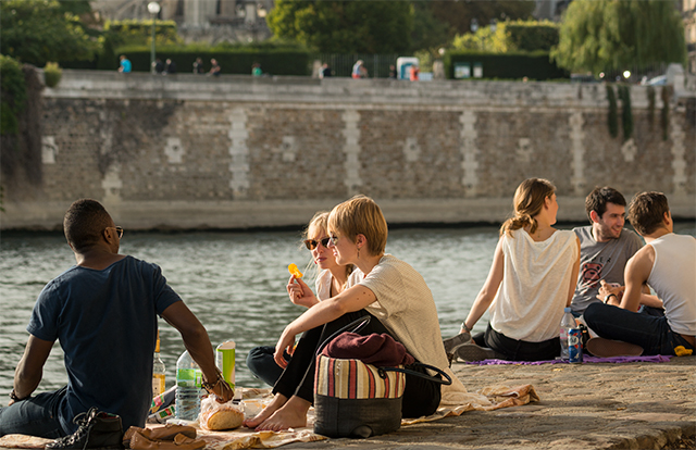 Picnic on River Seine in Paris, France