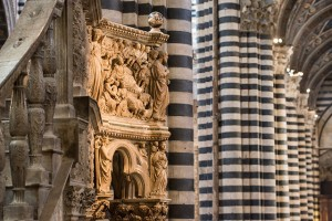 A close look at a sculpted relief in Siena Cathedral
