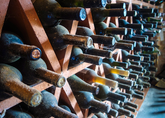 Wine bottles in a wine cellar out side of San Gimignano, Italy