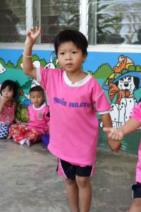 School children singing in Chiang Rai, Thailand