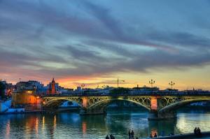 Iconic Triana Bridge at sunset.