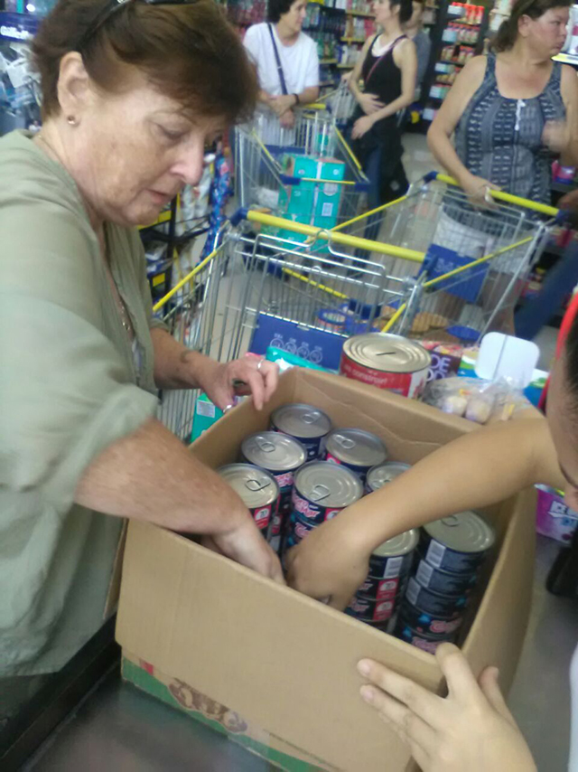 Buying supplies to donate at the local grocery store