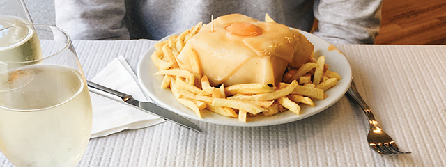 sandwich with cheese and gravy and fries