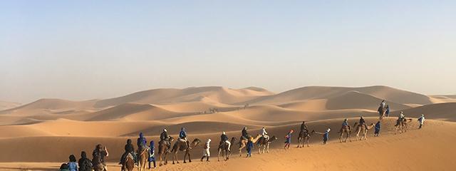 Morocco-Sahara-Desert-Camel-Ride-Travelers