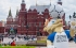 a statue of a lion balancing a soccer ball in front of Red Square, Moscow