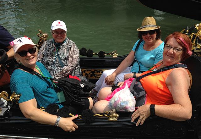 Travelers in gondola, Venice Italy