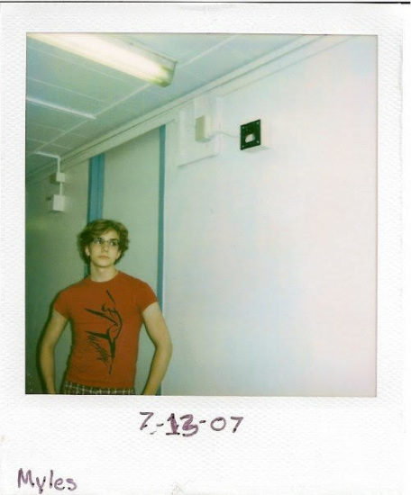 A polaroid photo of Myles Thatcher in his college dorm room in July 2007.