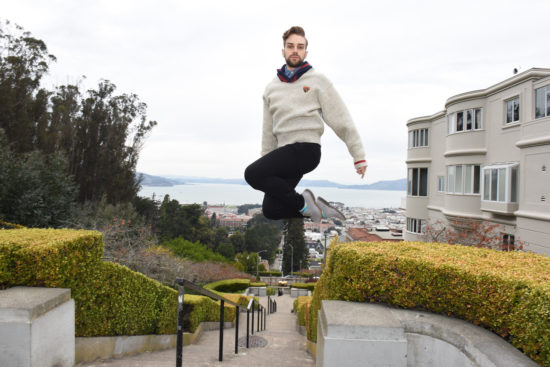 Queer dancer Myles Thatcher poses while jumping on top of Lombard Street in San Francisco.