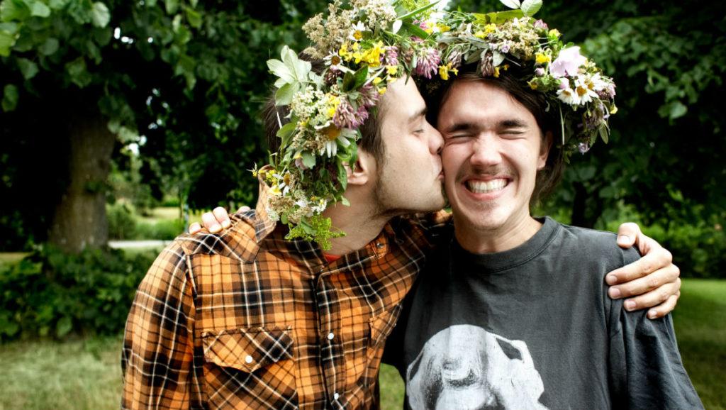 Men celebrating midsummer in Sweden