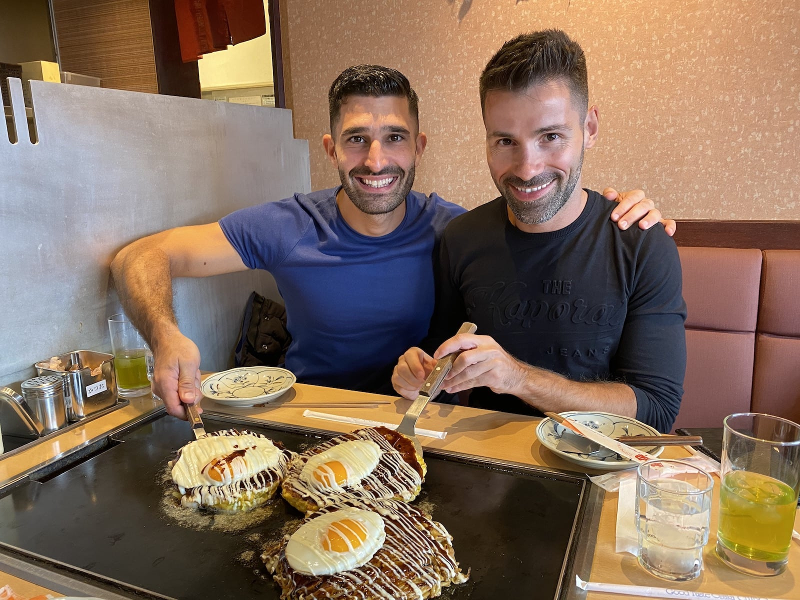 Gay travel bloggers Nomadic Boys try a Japanese dish in Tokyo.