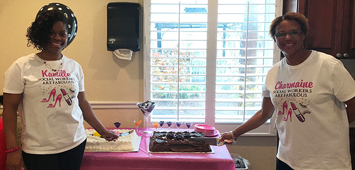 Two social workers standing next to each other with Social workers are fabulous tee shirts holding cake cutting utensils to cut two cakes
