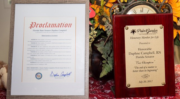 Proclamation from Senator Daphne Campbell and a plaque for her as a Member for life