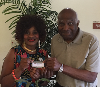 Mr. Joseph receives his Palm Garden membership card