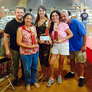 chili cookoff winners with their trophies
