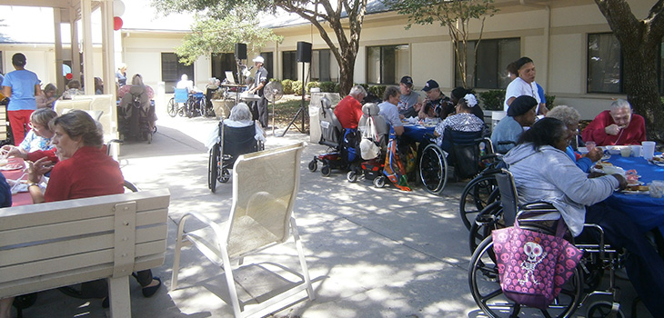 residents outside enjoying the memorial day bbq