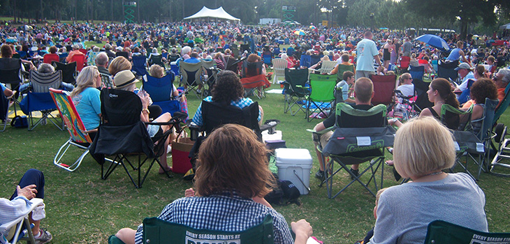 large outdoor gathering for symphony under the stars