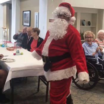 Staff member dressed up as Santa for the residents