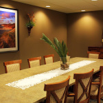 private dining area with artwork on the walls and plant accents