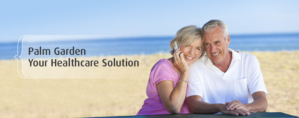 Couple at beach she is talking on cell phone with her arm around his shoulder – Palm Garden Your Healthcare Solution