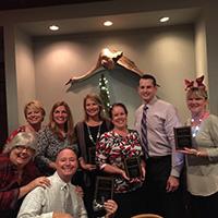 staff photo of winners of rehab award
