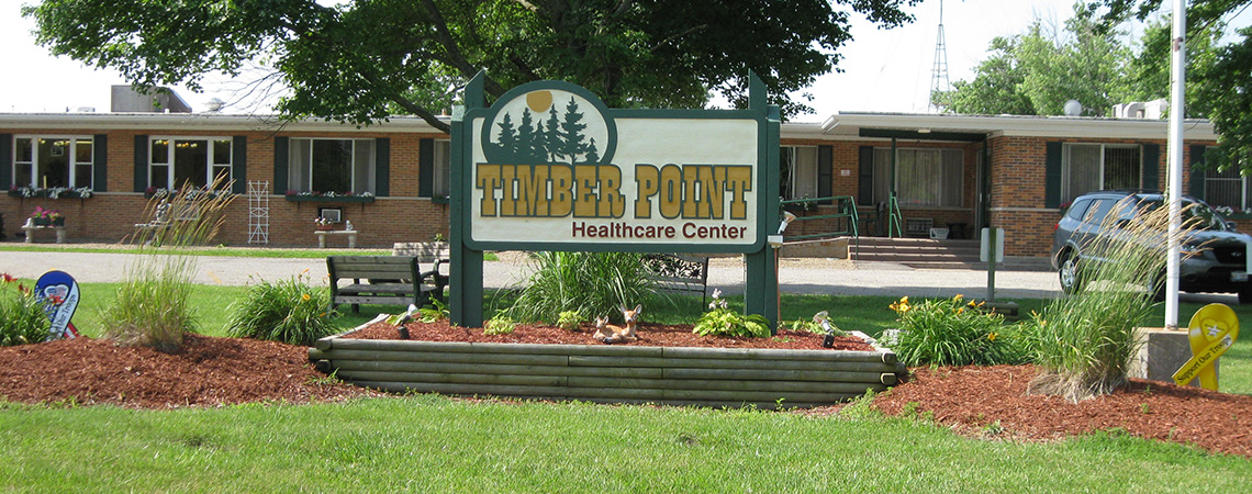 Timber Point sign out front surrounded by grass