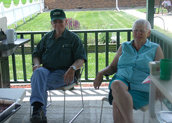 Two people sitting outside on a patio together