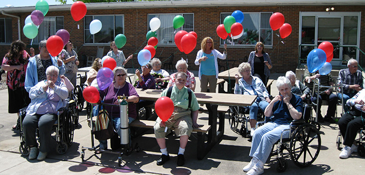 Residents outside holding balloons