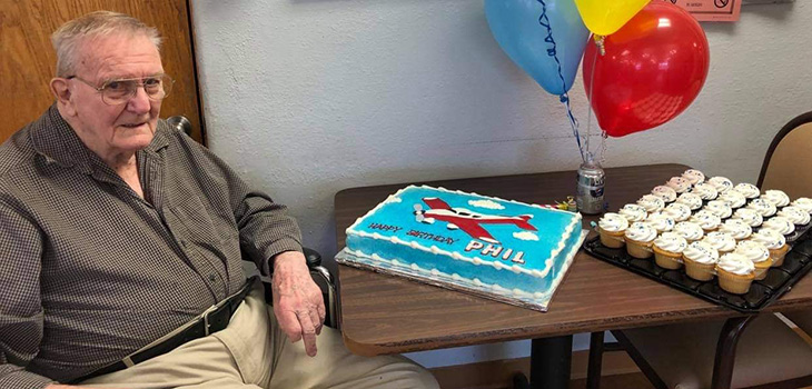 Timber Point resident with a cake
