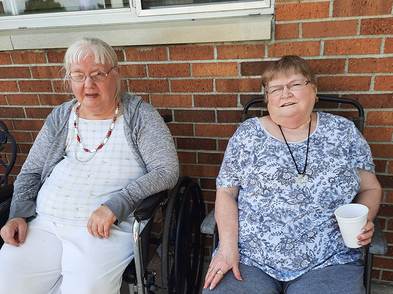 Timber Point residents enjoying the nice weather on the patio