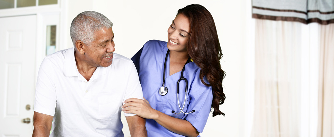 A nurse and resident smiling together