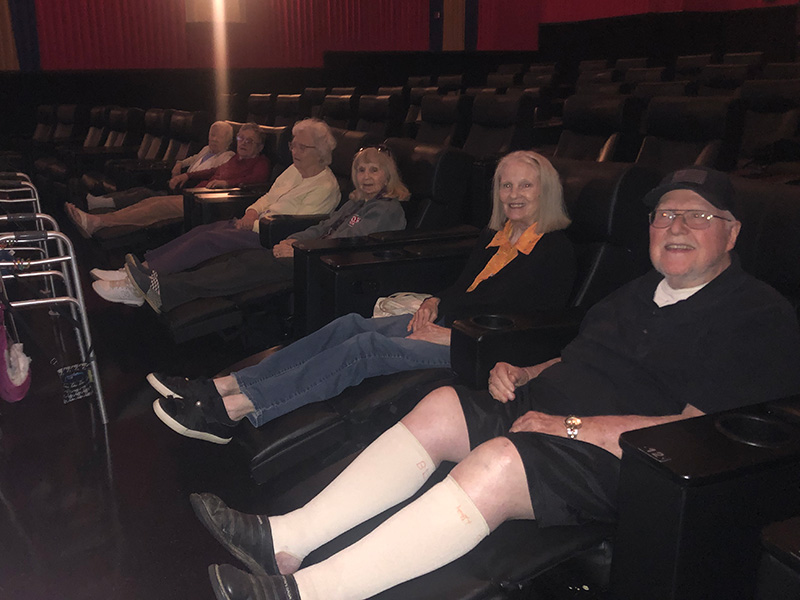 Residents putting their feet up and enjoying a movie