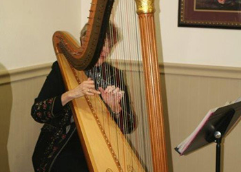 A woman playing a harp.