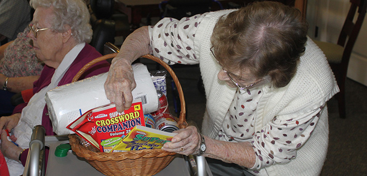 residents looking through gift baskets