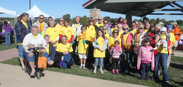residents at a donation event together in yellow shirts