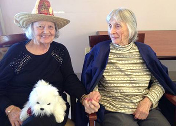 residents smiling with dog