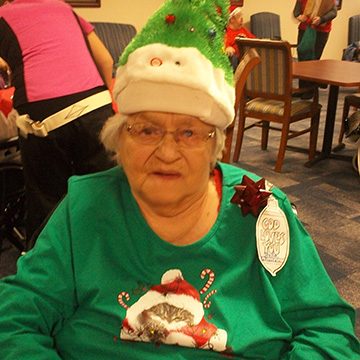 Resident smiling at the christmas party