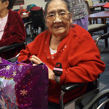 Resident opening gift at the christmas party