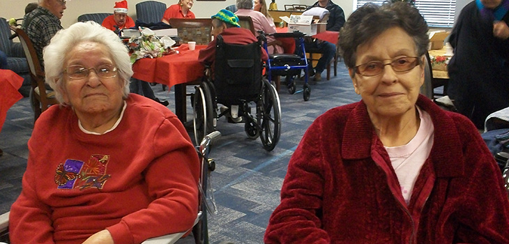 Residents smiling in christmas sweaters together