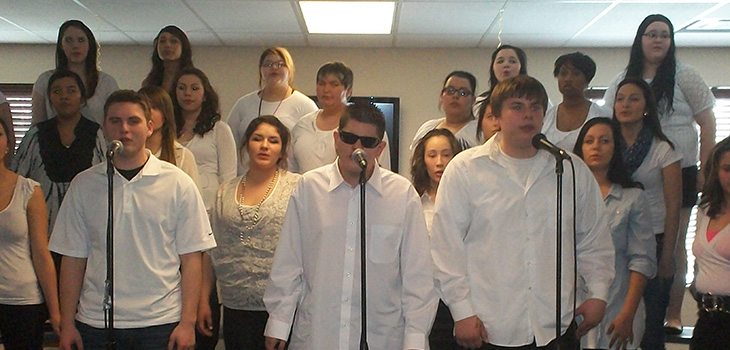 The high school choir singing at the facility