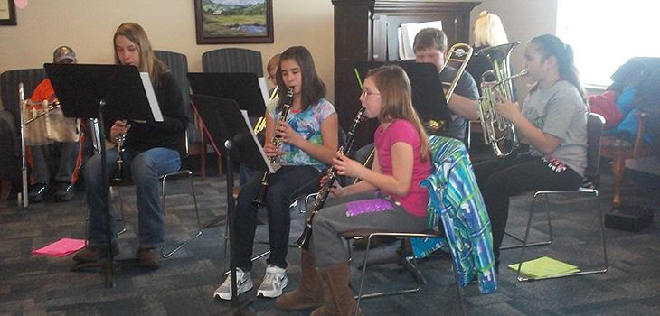 Junior high band playing at the facility