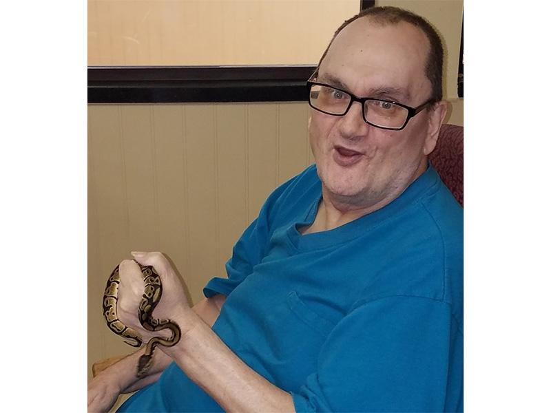Resident holding a snake