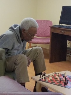 resident playing chess