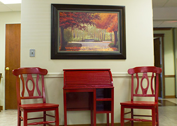Sitting area with a beautiful fall image above