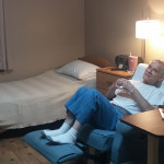 A resident sitting in his chair in his room relaxing