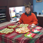 A staff member with food set up for the holidays