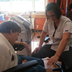 Rehabilitation staff member assisting a resident with exercises for recovery