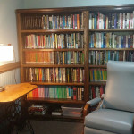 Resident library with 12 shelves full of books